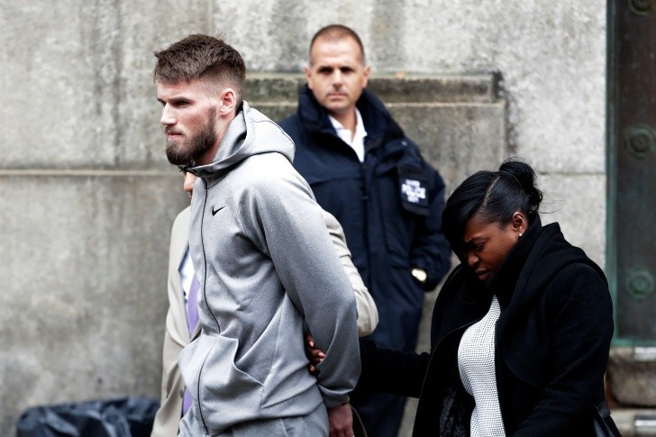 Mixed Martial Arts fighter Cian Cowley - Mixed Martial Arts fighter Cian Cowley, a friend of ultimate fighting star Conor McGregor, is led to an unmarked vehicle while leaving the 78th Precinct of the New York Police Department, Friday, April 6, 2018, in the Brooklyn borough of New York. Cowley and McGregor are facing criminal charges in the wake of a backstage melee McGregor allegedly instigated that has forced the removal of three fights from UFC's biggest card of the year. Video footage appears to show the promotion's most bankable star throwing a hand truck at a bus full of fighters after a Thursday news conference for UFC 223 at Brooklyn's Barclays Center. (AP Photo/Julio Cortez) UFC McGregor Scuffle